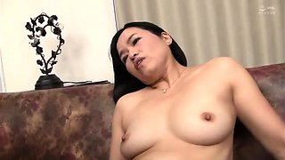 Mature Japanese lady fucks a dildo and seduces a young man