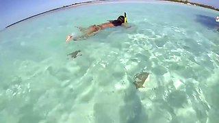topless russian swimming in tropical sea