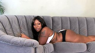 Ebony lesbians pleasure each other with a strapon