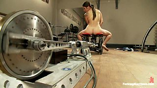 Slim brunette girl fingers her ass and gets toyed by a machine