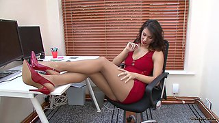 Sexy secretary in stockings gets naked and fingers her pussy
