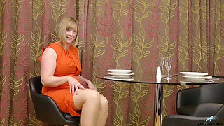 Mature woman April is finger fucking her stretched hairy snatch
