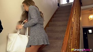 Ardent English nympho Natalia Forrest bends over the stairs to show nice bum