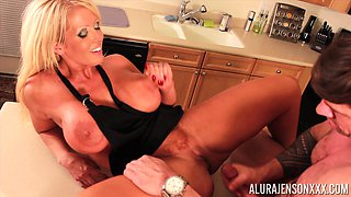 Attractive Alura Jenson and her man having erotic moments in a kitchen