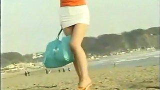 mini skirt girl on the beach