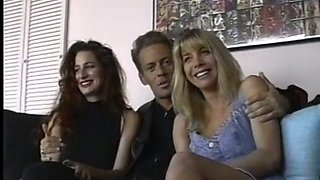 Beautiful and wild white vixens on the couch with one man
