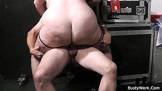 Fat ass plumper in fishnets rides boss cock