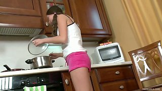 Cute young housewife Veda is having fun with sex toy in the kitchen