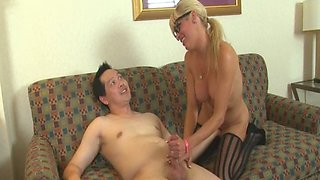 Teasing milf jerking fat cock in POV