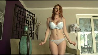 Stunning red head with massive boobs posing on a camera