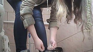 Lovely white blonde girl in blue jeans pisses on hidden cam