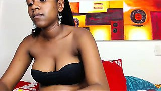Young black chick with big nipples fingers her shaved pussy