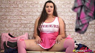 Full bodied cheerleader Cherry Blush posing on camera