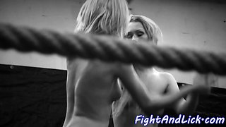 Gorgeous lesbians wrestling in a boxing ring