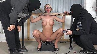 Slut rides a sybian fuck machine in bondage and sucks dick
