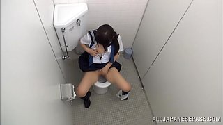 Long haired brunette masturbates fingering her pussy in toilet